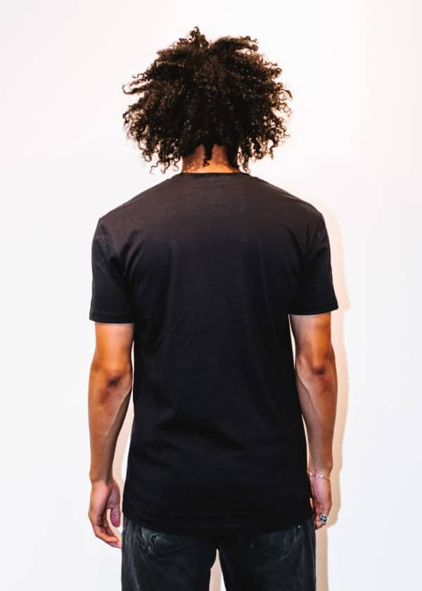 A man with Curly hair, showing his back, wearing a Black t-shirt