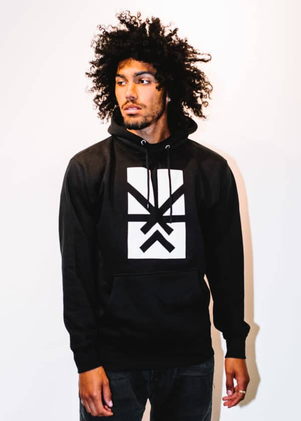 A man with Curly hair, showing his front side, looking to the right side, wearing a black hoodie shirt with a long sleeve, with Project Cannabis logo on the shirt