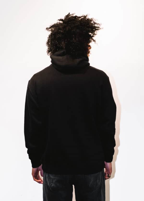 A man with Curly hair, showing his back, wearing a black hoodie shirt with a long sleeve